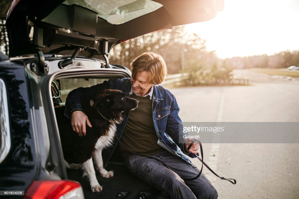 Man playing with his dog : Stock Photo