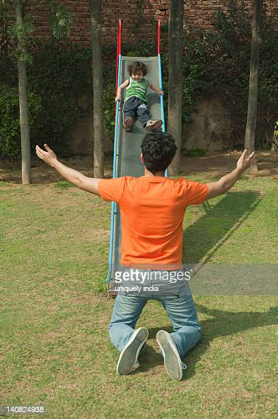 Man playing with his son in a garden