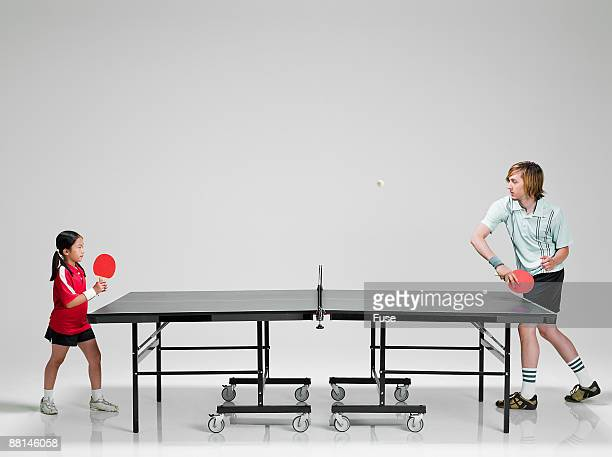 man playing young girl in ping pong - funny ping pong stock pictures, royalty-free photos & images