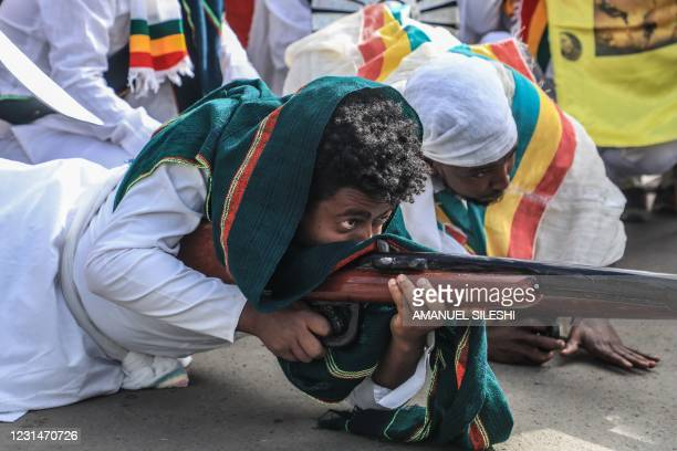 Man plays a role of a war veteran during the celebration of the 125th victory of Adwa, at Menelik square in Addis Ababa, Ethiopia, on March 2, 2021....