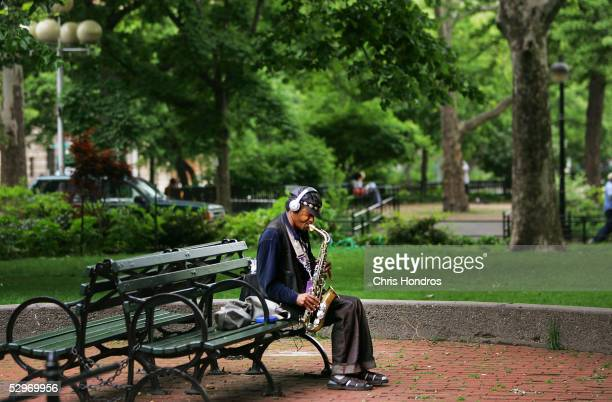 A man plays a saxophone in Washington Square Park May 23 2005 in New York City A renovation is planned for the Greenwich Village landmark which...