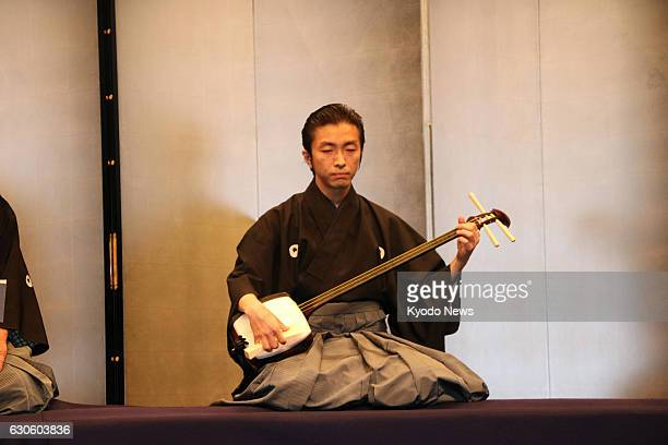 A man plays a shamisen during a performance of the Nagauta Samonkai at Uchisaiwaicho Hall in Tokyo on Dec 16 2016 The threestringed instrument is...
