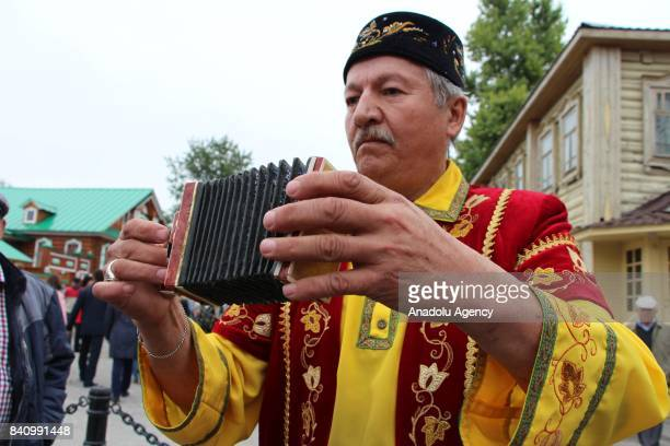 A man plays a small accordion during the 27th Republic Day of Tatarstan in Kazan the Republic of Tatarstan Russia on August 30 2017