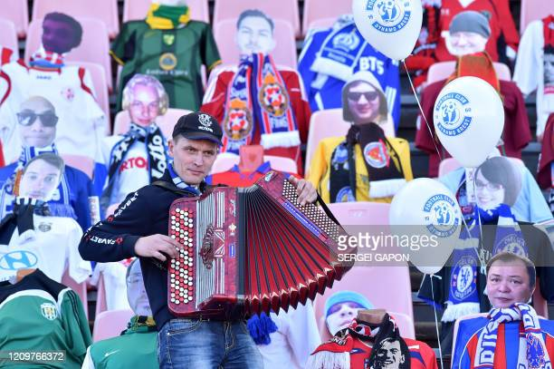 A man plays accordion in front of dummies displayed to replace audience due to the outbreak of the Covid19 caused by the novel coronavirus during the...
