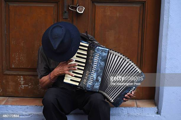 A man plays an accordion for tips on Friday July 03 2015 in Old San Juan Puerto Rico The historic area brings in countless tourists