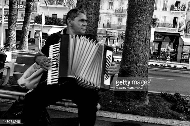 A man plays an accordion on the Croisette during the 65th Annual Cannes Film Festival on May 23 2012 in Cannes France
