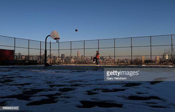 A man plays basketball on a court in a park in Jersey City New Jersey with the skyline of New York behind him January 10 2015