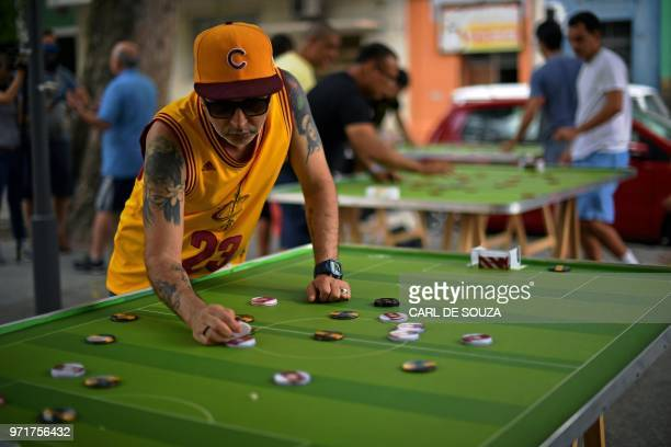 A man plays Button Football in Rio de Janeiro Brazil on May 19 2018 Every weekend some 20 to 30 players meet in Rio de Janeiro to play with their...