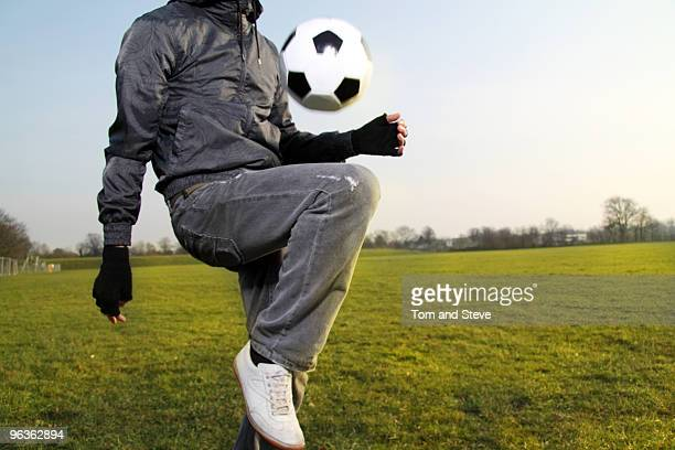 Man plays football in a large field