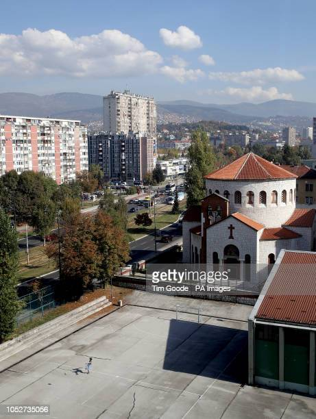 Man plays football in the Marijin Dvor district of Sarajevo next to the street Zmaja od Bosne, known as 'Sniper Alley' during the siege of Sarajevo