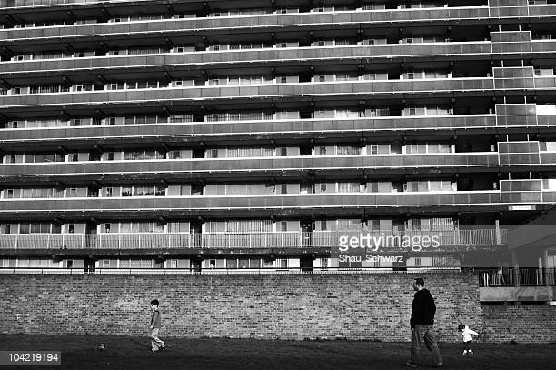 A man plays football on the lawn in front of the Heygate Estate building on March 31 2007 The London County Council initiated a major development of...