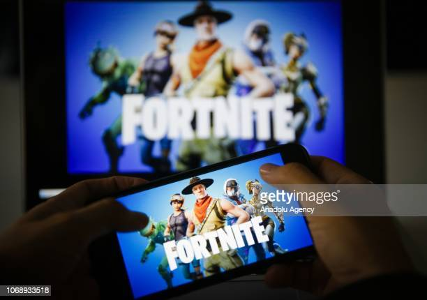 A man plays Fortnite game on smartphone in Ankara Turkey on November 26 2018