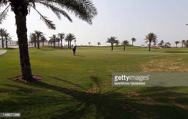 A man plays golf on a course in the Saadiyat district an Island off the city of Abu Dhabi on June 7 2012 The time when Beirut Baghdad and Cairo were...
