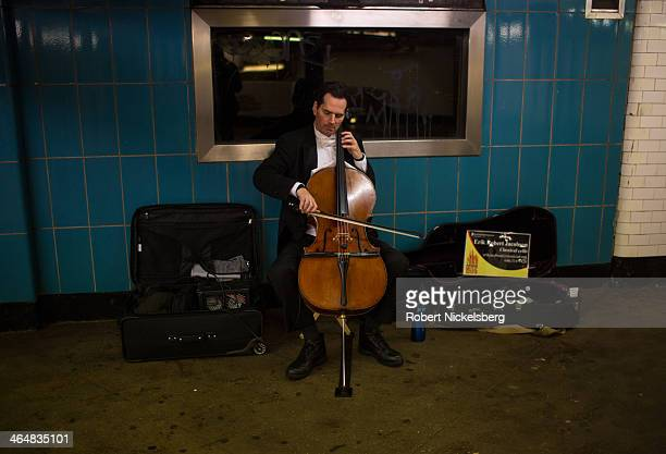 Man plays his cello at the Borough Hall subway station during a snow storm on January 21, 2014 in the Brooklyn borough of New York City. The storm...