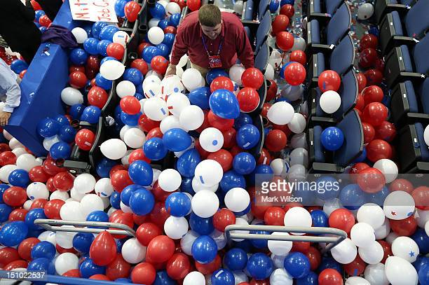 A man plays in balloons after Republican presidential candidate former Massachusetts Gov Mitt Romney accepted the nomination during the final day of...