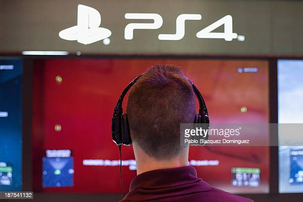 A man plays on a Playstation 4 at Madrid Games Week in IFEMA on November 9 2013 in Madrid Spain Madrid's first edition of the Games Week runs from...