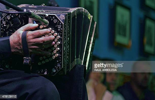 A man plays teh bandoneon during a tribute to tango singer and composer Carlos Gardel at the 'Casa Gardeliana' Museum in Medellin Antioquia...