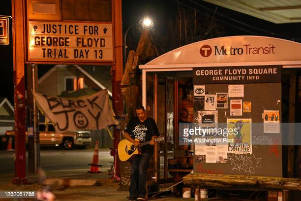 Man plays the guitar at the intersection of Chicago Avenue and 38th Street also know as George Floyd Square on March 29, 2021 in Minneapolis,...