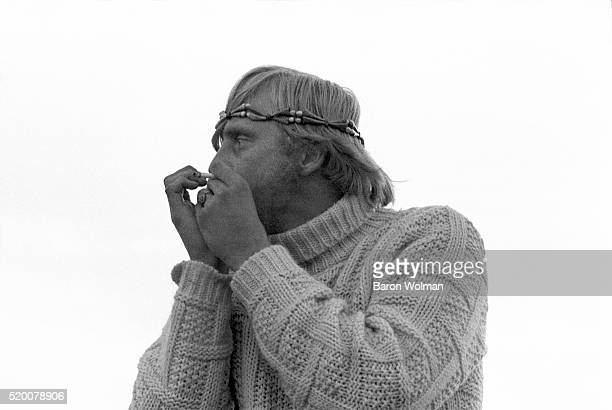 A man plays the harmonica at the Altamont Speedway Free Festival in Northern California held on Saturday December 6 1969