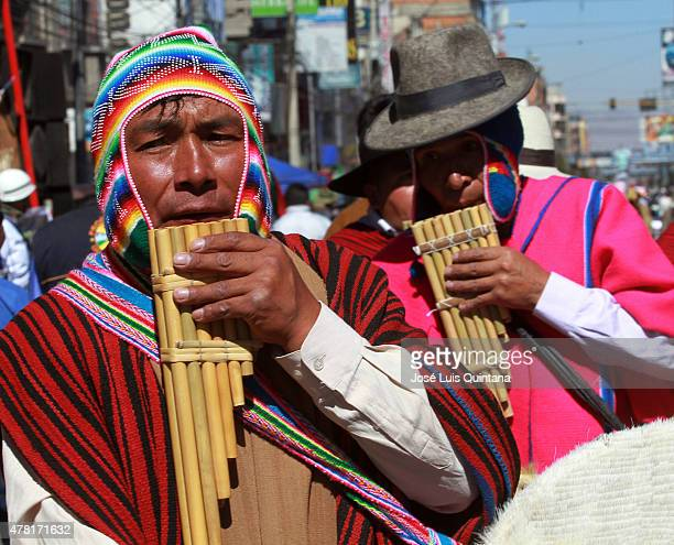 A man plays the panpipe during celebration of the AndeanAmazonic New Year 5523 on June 21 2015 in El Alto La Paz Bolivia
