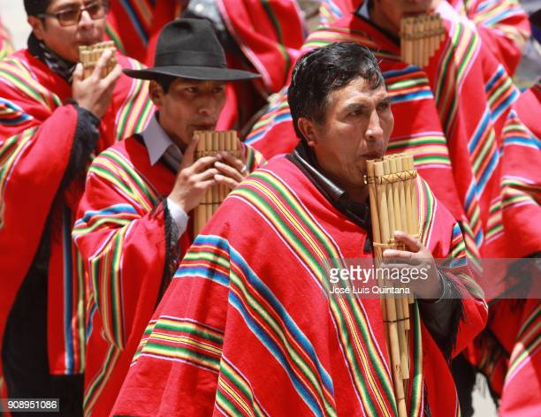A man plays the panpipe in front of the Government Palace during the celebration of the 12th anniversary of Evo Morales' government at Murillo Square...