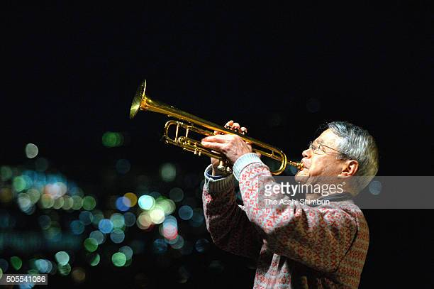 A man plays trumpet in commemoration of the victims as Japan marks the 21st anniversary of the Great Hanshin Earthquake on January 17 2016 in...