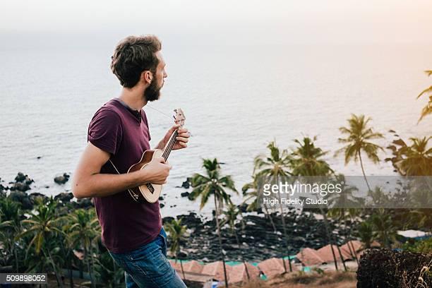 Man plays ukulele