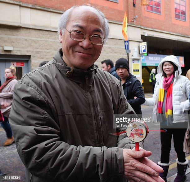 A man plays with a toy drum as the Chinese community come together to welcome in the Chinese New Year on February 22 2015 in Newcastle upon Tyne...