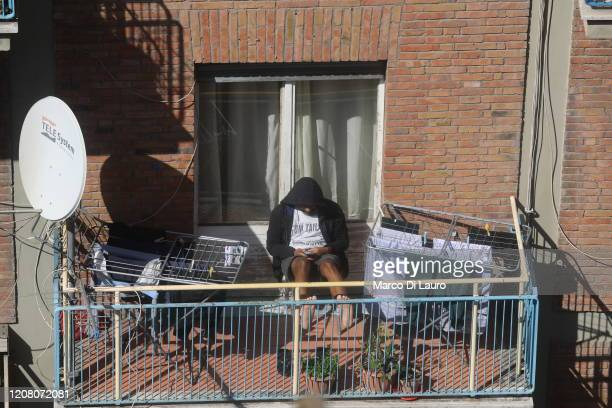 A man plays with his cellphone during lockdown on March 23 2020 in Rome Italy As Italy extends its nationwide lockdown to control the spread of...