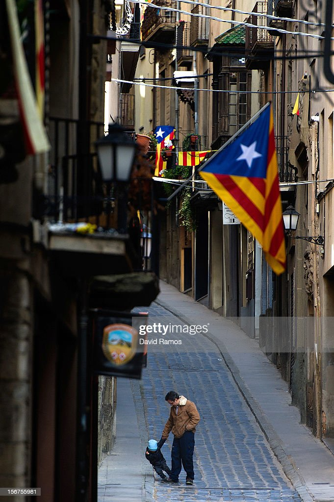 A man plays with his son beneath pro-independent Catalonia flags on November 20, 2012 in Vic, Spain. Catalans will be voting in Parliamentary elections on November 25.