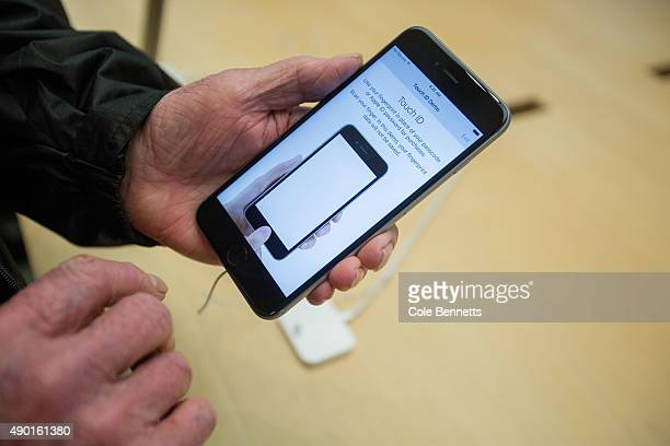 A man plays with the iPhone 6s Plus at Apple Store on September 25 2015 in Sydney Australia Some eager iPhone fans arrived to queue at 4am on...