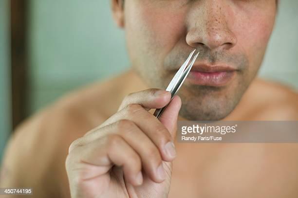 Man Plucking Nose Hair
