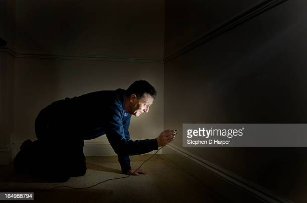 Man plugging something into a power socket