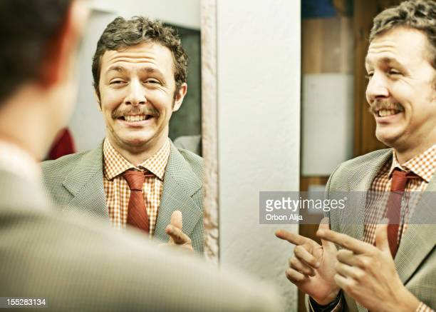 man pointing at reflection in mirror - vanity stock pictures, royalty-free photos & images