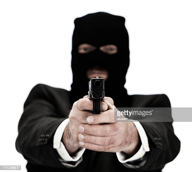 Man pointing gun