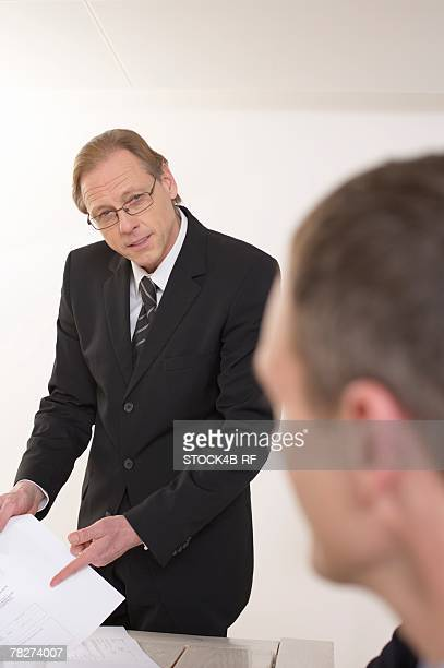man pointing on a paper - head cocked stock pictures, royalty-free photos & images