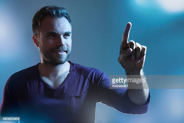 man pointing on imaginary touchscreen - index finger stock pictures, royalty-free photos & images