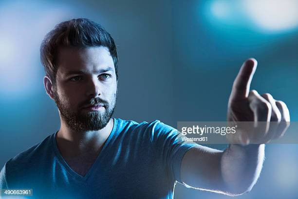 man pointing on imaginary touchscreen - touch sensitive stock pictures, royalty-free photos & images
