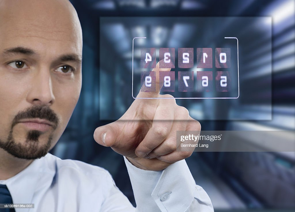 Man pointing on numbers, close-up (digital composite) : Stockfoto