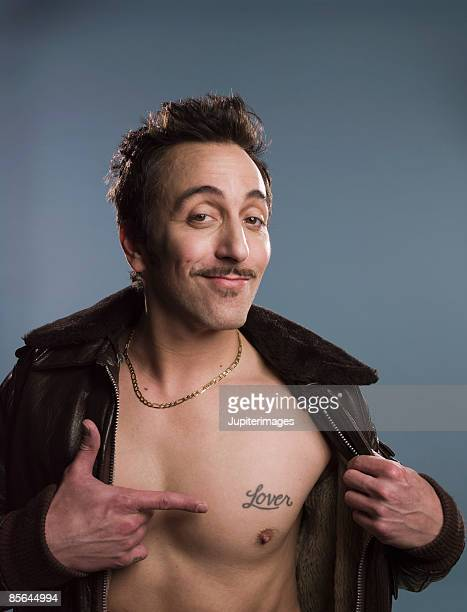 Man pointing to tattoo