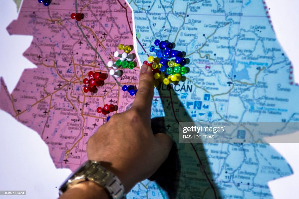 Culiacan Sinaloa Mexico Map.A Man Points At A Map Of Culiacan Showing The Points Where Missing