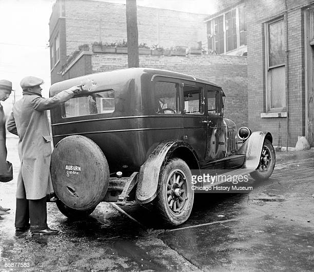A man points to bullet holes on the automobile of Edward 'Spike' O'Donnell in Chicago Illinois 1925 Frank McFarlane a Capone ally and O'Donnell rival...