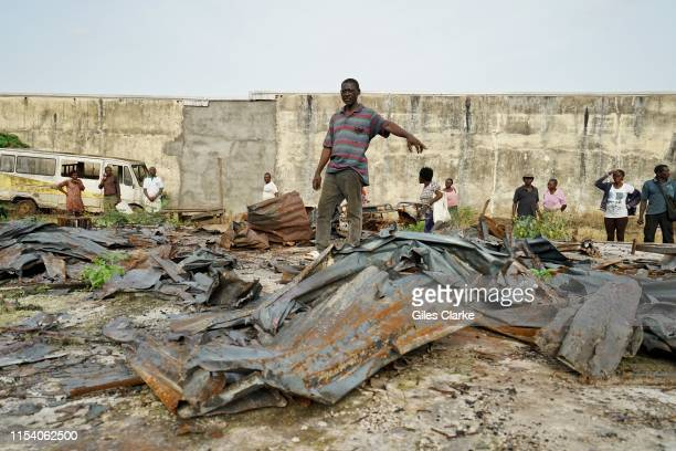 A man points to what is left of his house on May 11 2019 that was burnt down by Cameroonian military forces in January 2019 near BueaCameroon In 2017...