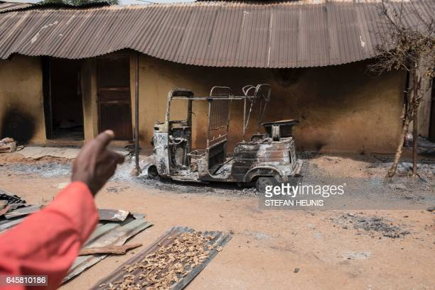 A man points with his hand the damages in village of Bakin Kogi in Kaduna state northwest Nigeria that was recently attacked by suspected Fulani...
