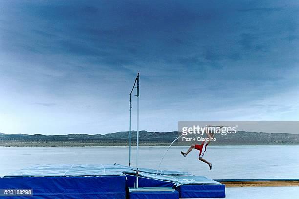 Man Pole Vaulting in Salt Flat