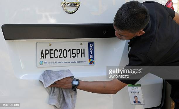 Man polishes a car, one of the hundred of new cars that will be used during the Asia Pacific Economic Cooperation summit to be held in the...