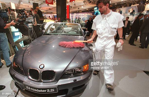 A man polishes the BMW Z3 roadster 22i during the Paris Car Show 28 September 2000 which takes place from 28 September until 15 October 2000 AFP...
