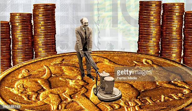 Man polishing dollar coin with old fashioned floor polisher