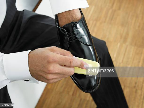 Man Polishing Dress Shoes