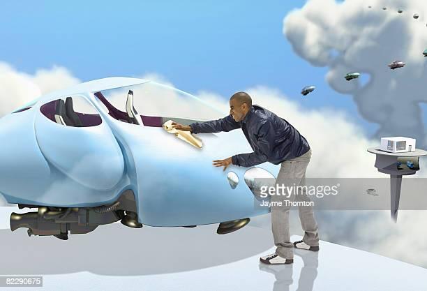 Man polishing future car
